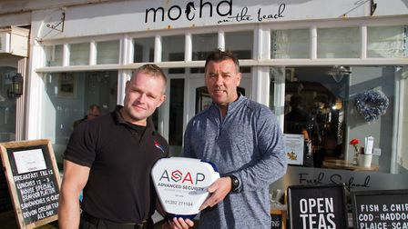 Ben Waring with Nigel Stout outside Mocha in Sidmouth. Ref shs 48 17TI 3967. Picture: Terry Ife