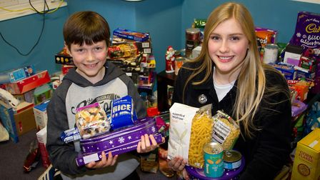 St Johns students Holly Rowe and Michael Byrne with some of the items they will be donating to Sidmo