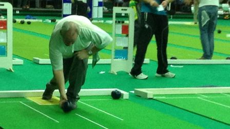Sidmouth short mat bowler Andy Thompson in action