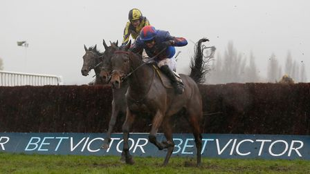 Splash Of Ginge and Tom Bellamy lead the field over the last fence before going on to win The BetVic