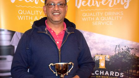 Saj Patidar of Sidmouth 2nd XI with the Premier Division winners trophy