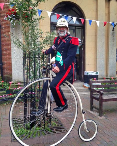 Velo Vintage's main man astride his Penny Farthing in Sunny Sidmouth. Picture: Ian Woolger