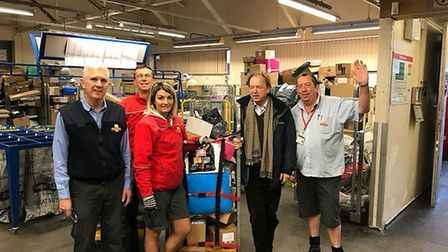 East Devon MP Sir Hugo Swire with postal staff at Sidmouth's Royal Mail delivery office. Picture by