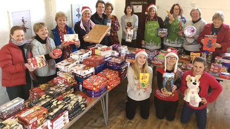 Sid Valley Food Bank volunteers made up hampers full of mince pies, crackers, presents and all sorts