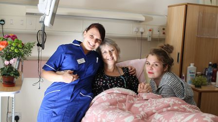 Hospiscare Nurse Rachel, Bronia and her daughter Carla on the ward at Searle House