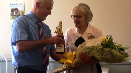 Fields of Sidmouth manager Brian Dowie had the pleasure of presenting Pam Long with a bouquet of flo