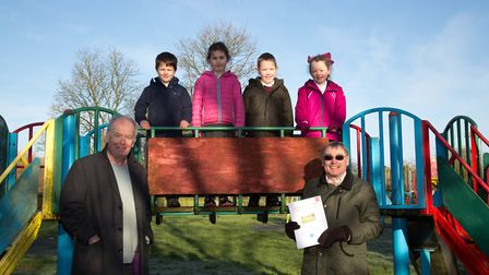 David Birch and David Boyle with year one children from Tipton Primary School at the play area. Ref