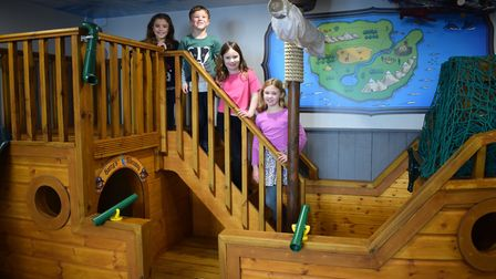 Jemima Plank, Joshua Plan, Imogen Woollan and Olivia Woollan test out the new pirate ship at Tickety
