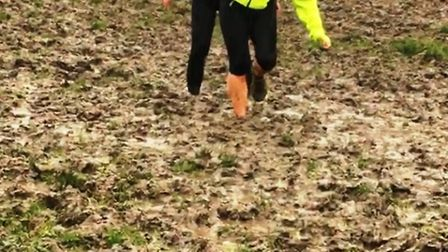 Four Trigs training and runners navigating their way through a sea of mud.