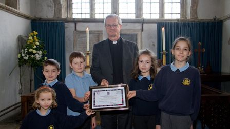 The Arch Deacon presenting the school with an award for their good Siams Report. Ref shb 04 18TI 695