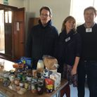The Sid Valley Food Bank's Andie Milne with Tom De Remer and Tom Lovatt