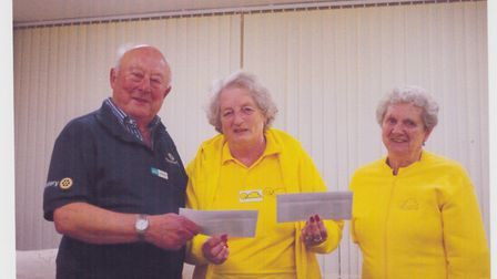 Win (centre) presenting cheques to Jim Cobley, from Shelter Box and Jean Kingdom, president of Sid