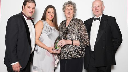 Alastair Franks, Andrianna Franks, Doreen Franks and Roger Franks collecting their award. CREDIT: Ni