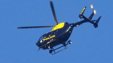 The police helicopter flew over Sidmouth. Ref shs 0278-04-15SH. Photo Simon Horn