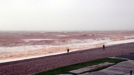 A very red sea when the storm whipped up the sand - December 2015. Picture: Barbara Mellor