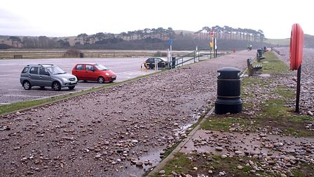 There was a storm with a huge high tide in October 2006 resulting in pebbles being thrown right into
