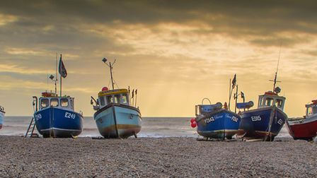 The fishing boats of Beer safe on the beach on a stormy winter day. Picture: Paul Newman