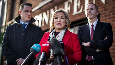 Sinn Fein Vice President Michelle ONeill with party colleagues John Finucane (left) and Chris Hazza