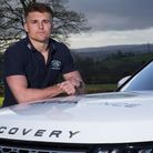 Henry Slade by a Land Rover Discovery.The Exeter Chiefs star out his driving skills to the test duri