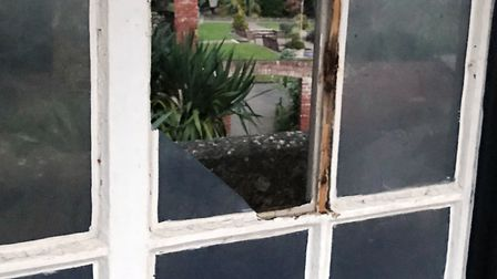 A smashed window in Connaught Gardens.