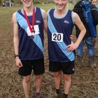 Sidmouth runners Toby Garrick and Will Ashby in the blue shirts of the Exeter and East Devon team.