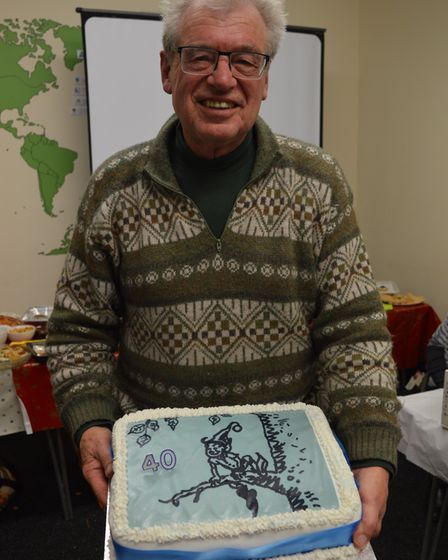 Richard Coley was presented with a cake for 40 years of service of the Pixie Day.