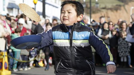 Fun at one of the previous Sidmouth pancake races. Ref shs 3153-08-15TI. Picture: Terry Ife