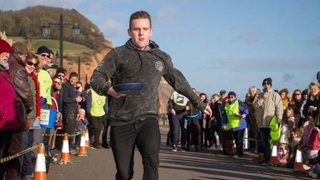 Pancake Races in Sidmouth organised by Sid Valley Rotary Club. Ref shs 07-18TI 7881. Picture: Terry