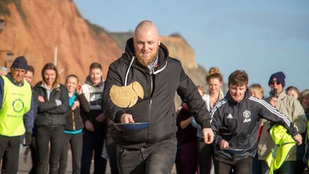 Pancake Races in Sidmouth organised by Sid Valley Rotary Club. Ref shs 07-18TI 7863. Picture: Terry