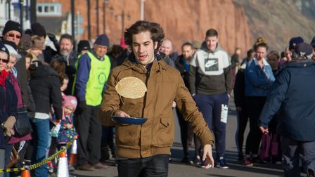 Pancake Races in Sidmouth organised by Sid Valley Rotary Club. Ref shs 07-18TI 7842. Picture: Terry