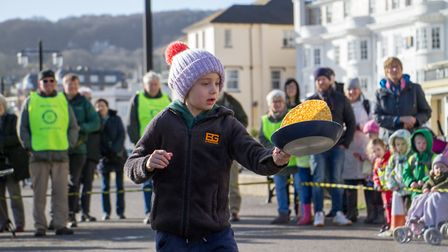 Pancake Races in Sidmouth organised by Sid Valley Rotary Club. Ref shs 07-18TI 7807. Picture: Terry