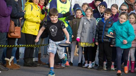 Pancake Races in Sidmouth organised by Sid Valley Rotary Club. Ref shs 07-18TI 7792. Picture: Terry