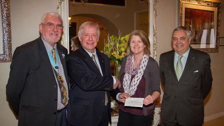 Royary Club of Sidmouth members George Eamer,Steve Gunnell and Nigel Sharp present a cheque to Gill