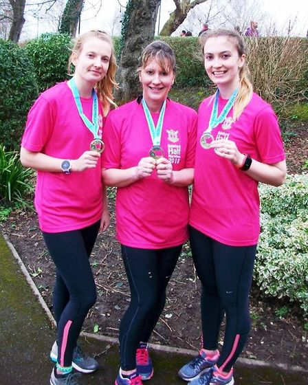 Sidmouth Rinning Club members Lynda Hawkins with daughters Kaylee and Jade wearing the medals they r