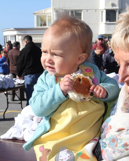 Cute one year old Rose Cooke with her bun on Good Friday, 2014. Picture: Simon Horn