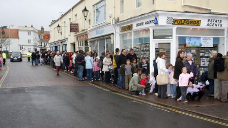 The Sidmouth Easter buns giveaway was held in the Methodist church due to poor weather in 2009.Pic
