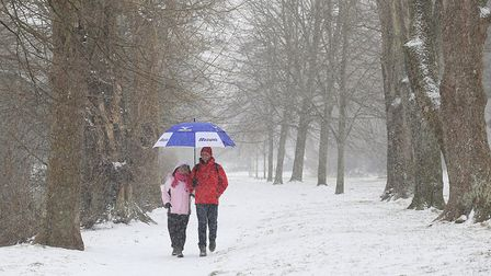 A couple make thier way through heavy snow in Sidmouth, Devon. Picture: Ian Williams