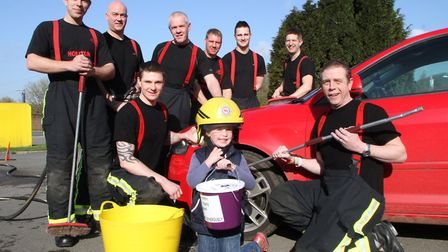 Honiton firefighters were joined by new recruit, Elli Sparks aged five to help them wash cars in aid
