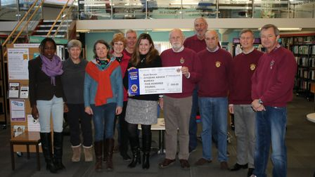 Sidmouth Lions Vice President Alex Blyth presenting the £500 cheque to Hilary Nelson, CEO, Strategy