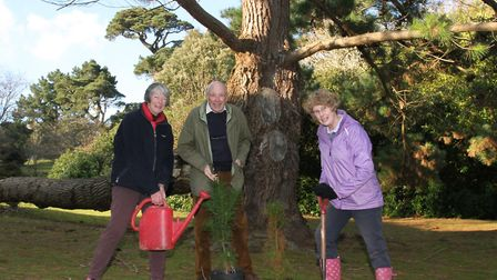 Sidmouth Arboretum's Diana East with local residents Martin McInerney and Sue Dent with two young Mo