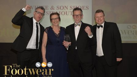White and Son Shoes owner Steve White & manageress Anne receiving the award.