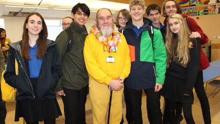 Councillor Douglas Hall with The King's School students following his victory at a political speed d