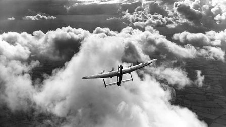 An Avro Lancaster embarks on a mission in August 1943. (Photo by Charles E. Brown/Royal Air Force Mu