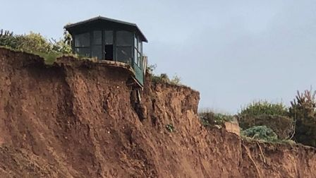 A garden shed has been left perilously close to the edge following a recent cliff fall. Picture: Ann