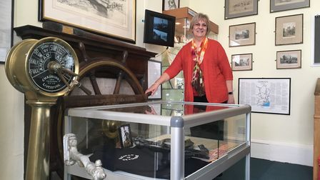 Val Haramis with her late father's items on display at Sidmouth Museum.