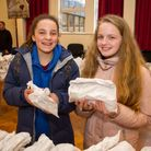 Jasmin Shackleford and Bethany Parsons were first in the queue at the Sidmouth Easter Bun giveaway.