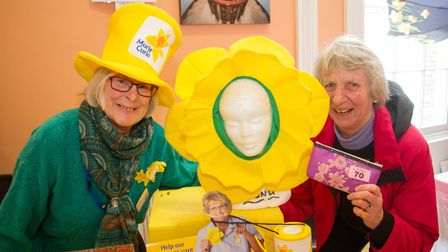 Marie Curie volunteer Maggie Tinsley with Henrietta Bradshaw, one of the raffle winners at the Daff