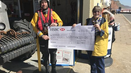 Guy Russell from Sidmouth Lifeboat is presented a cheque of £725 by Helen Croft.