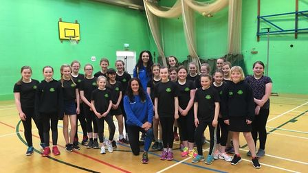 Sidmouth Netball Club youngsters with Team Bath duo Rachel Shaw and Paige Reed.