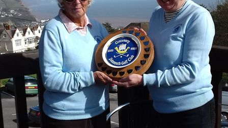 Sidmouth ladies captain, Sheila Faulkner presenting the Centenary Plate to the presidents team capta